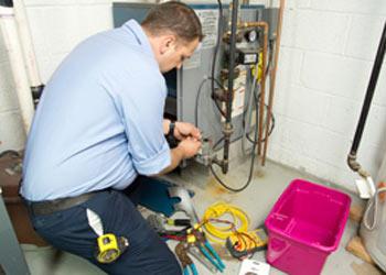 man repairing furnace